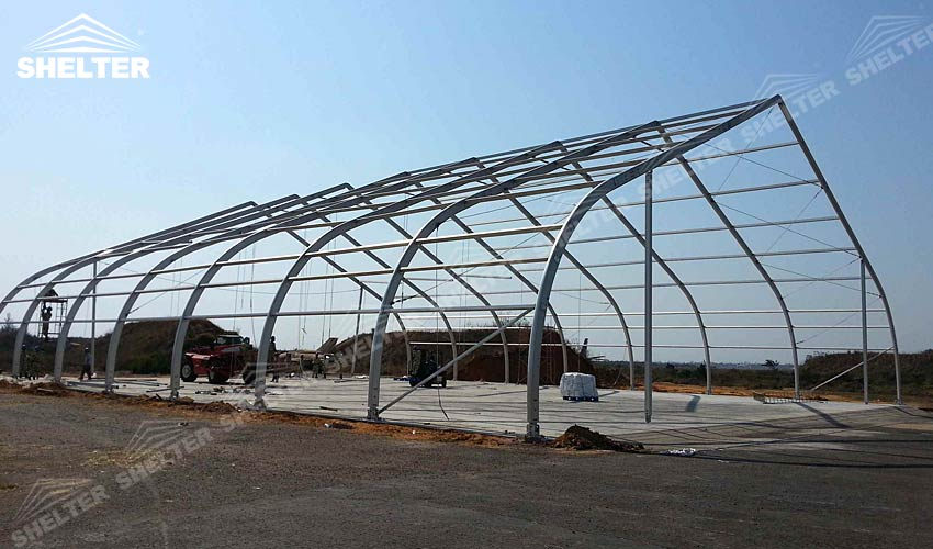 tensil fabric structure - event canopy - aircraft hangar - Shelter tension fabric structure for sale - helicopter hangar tent - aircraft hangar structures - private jet hangar structure - Shelter airplane hangar tents for sale (3)